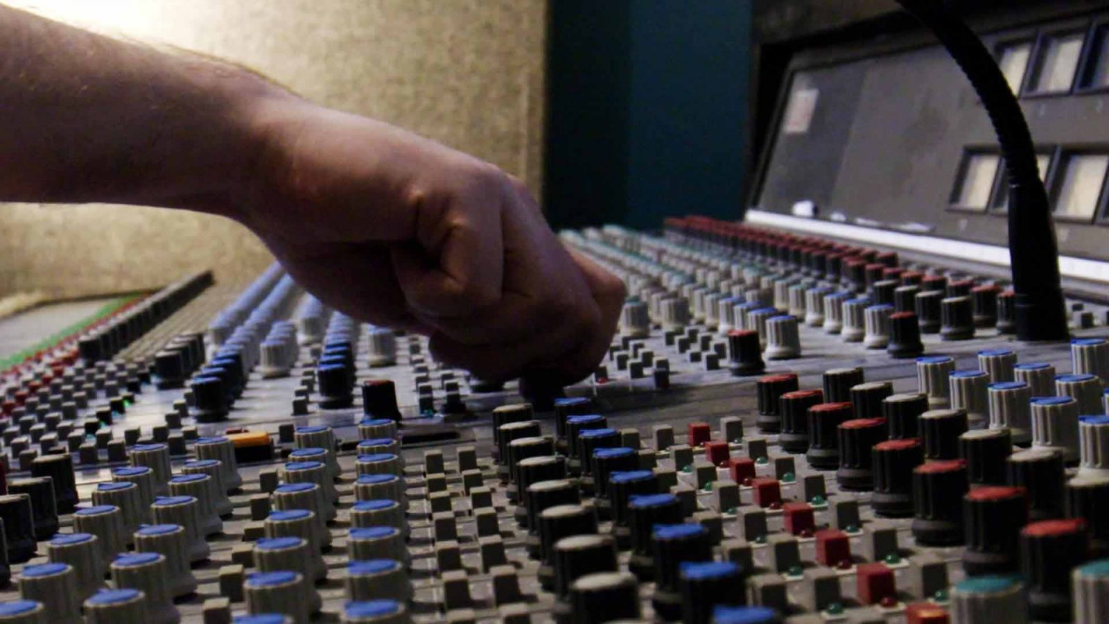 hand with dda 48 channel analogue mixing console